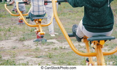 People Engage in Sports Training Equipment on the Street -...