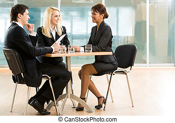 Business meeting - Three business partners discussing...