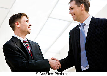 Successful partnership - Portrait of two happy businessmen...