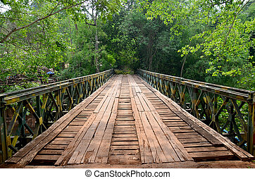 Wooden with Steel bridge for cross over stream river from...