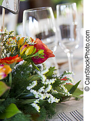 Close up of a floral bouquet as a centrepiece on a table,...
