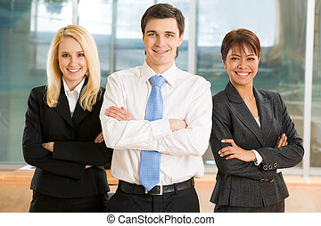 Friendly group - Image of cheerful colleagues keeping their...