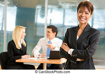 Leader of working team - Elegant woman in smart suit looking...