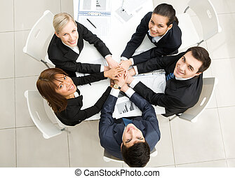 Support - Image of business people with their hands on top...