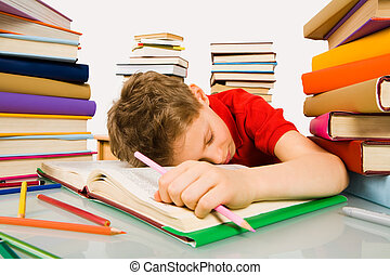 Sleep during lesson - Image of tired schoolboy sleeping on...