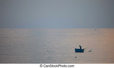 Fisherman on a round boat out to sea