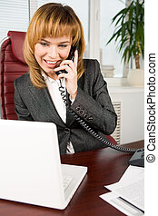 Modern businesswoman - Image of successful female looking at...