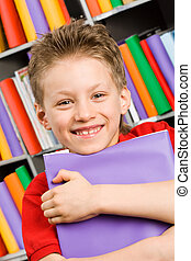 Schoolboy - Portrait of handsome boy with violet book in...