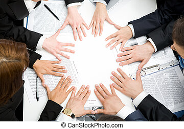 Unity - Image of business people keeping their hands next to...