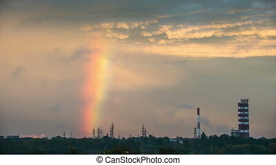 Clouds in the Sky and Rainbow are Moving over the City,...