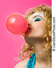 Having fun - Image of sexy girl blowing big red bubble with...