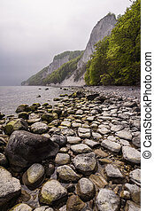 Chalk cliffs on shore of the Baltic Sea on the island...