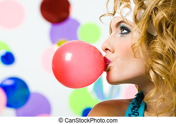 Blowing bubble gum - Profile of gorgeous female blowing...