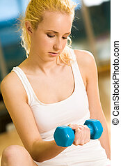 Physical activity - Portrait of strong female doing exercise...