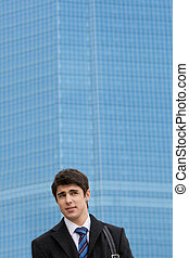 Businessman outdoors - Image of confused guy looking aside...