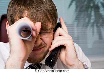 Business captain - Close-up of playful man with paper roll...