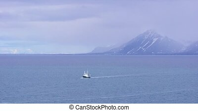 Expedition boat in the arctic environment near Svalbard -...