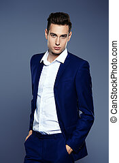 white collar style - Portrait of a handsome young man in...