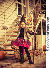 sorcerer girl - Pretty little girl in a costume of witch...
