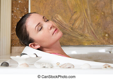 Taking bath - Image of relaxing woman with closed eyes...