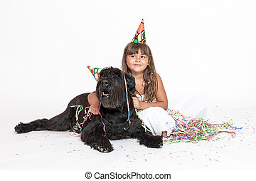 Cute little girl is embracing black dog on the white - Cute...