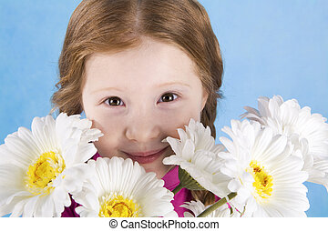 Behind flowers - Portrait of cute girl looking from behind...