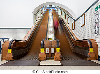 an wooden escalator - at the station have several wooden...
