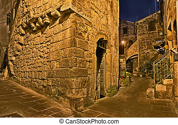 Pitigliano, Tuscany, Italy: alley in the old town -...