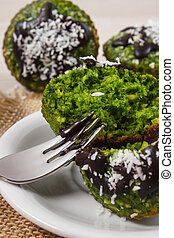 Fresh muffins with spinach, desiccated coconut and chocolate...