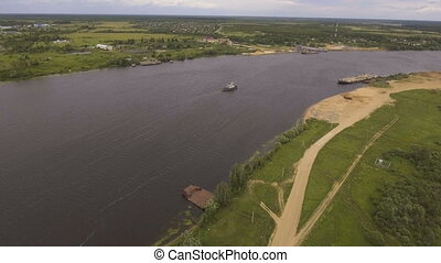 Aerial view:Tugboat on the river. - Aerial view:tug sailing...