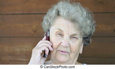 Elderly woman talking on the cell phone