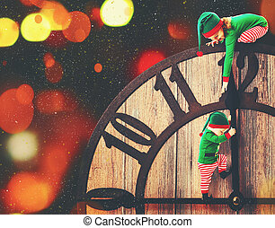 Christmas concept. Two little elf helper of Santa on...