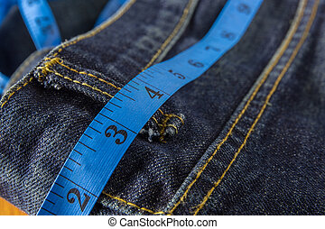 diet concept, jeans with measure tape