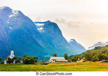 Oppstryn Church in Norway - Mountain landscape and the white...