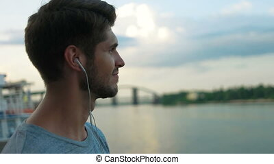 Man listening to music on the city center.