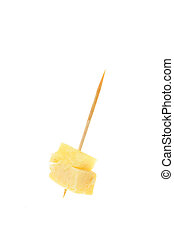 Party nibble, cheese and pineapple on a cocktail stick