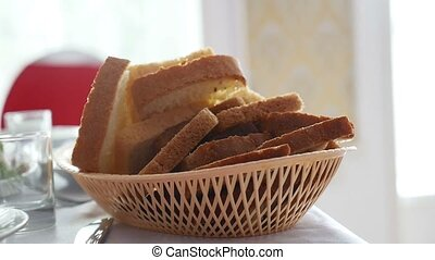 sliced bread in cup placed on table in a restaurant video -...