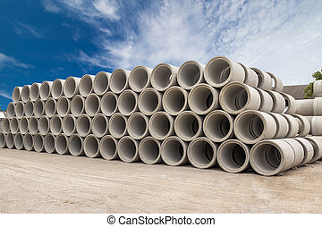 Stack of concrete drainage pipes for wells and water...