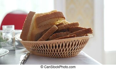sliced bread in cup placed on table in restaurant video -...