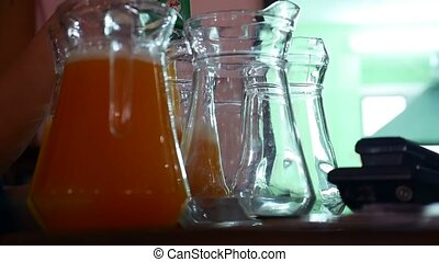 Bartender pours juice in glass healthy eating jars video -...