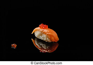 Sushi and red caviar on black acryle with reflection - Sushi...