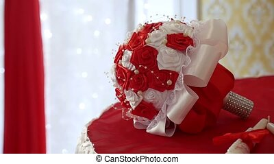 red wedding bouquet on the table in a beautiful room wedding...