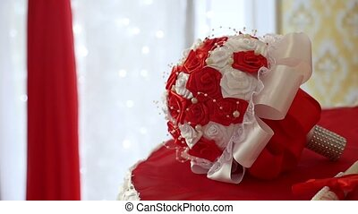 red wedding bouquet on the table in a beautiful room video...
