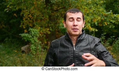 man in a leather jacket Autumn talking hand video gestures...