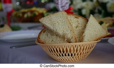 sliced bread in a cup placed on a table in a restaurant...
