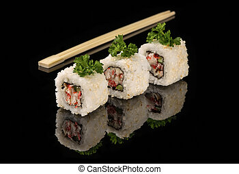 White beaters and sticks for sushi on black acryle with...