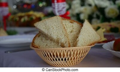 sliced bread in a cup placed on table in a restaurant video...