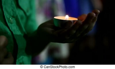 child holds a candle at night lit candle religion - child...