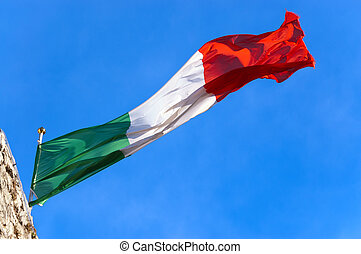 Italian Flag on a Clear Blue Sky