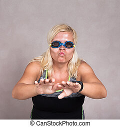 Woman in swimming goggles learning to swim - Portrait of a...